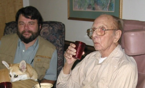 Me visiting my dad in 2003 (with Vera on my lap)