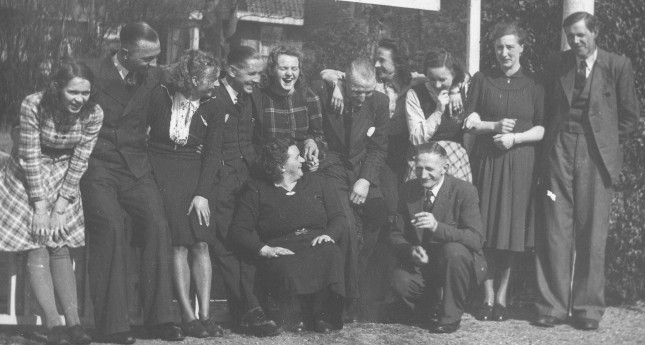 Group photo outside my grandparent's cafe. Grada, my dad, my mom, ??, Truus, Henk De Lange, Ada Wammes, Rie, Door De Lange, ? Vendrig My mother's father and mother in the foreground.