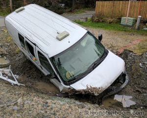 Van, expertly wedged into a deep roadside ditch.